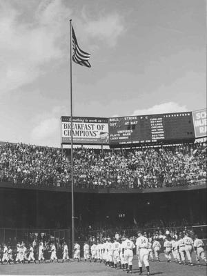 The original flagpole is visible in this photo from the Tigers' 1941 home opener at what was then called Briggs Stadium.