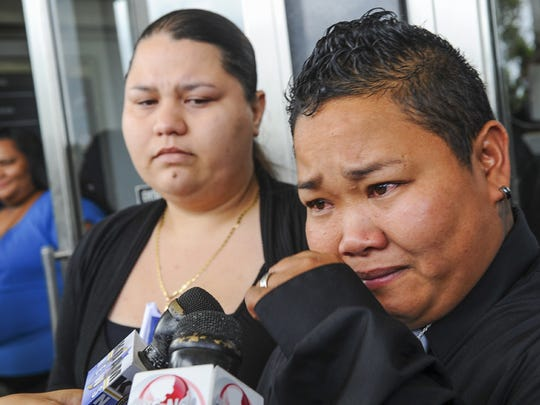 Loretta Pangelinan, right, wipes tears of joy from her eyes as she and her partner, Kathleen Aguero, speak to reporters on the steps of the U.S. District Court of Guam building in Anigua on June 5. The couple filed a lawsuit in April after they were denied the application for a marriage license at the Department of Public Health and Social Services, but on June 5, the couple won a ruling handed down by a federal judge, that declares a Guam law, that defines marriage as a union between couples of the opposite sex, to be unconstitutional.