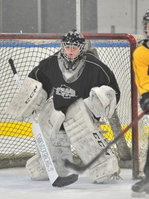 Central Wisconsin Storm senior Renee Hosler has posted a 1.86 goals against average in her first season as the starting goalie. Storm's goalie Renee Hosler guard the net during Monday practice at the Marathon County Park Ice Arena in Wausau.
