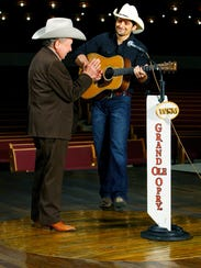 "Little Jimmy Dickens, left, and Brad Paisley sing ""May"