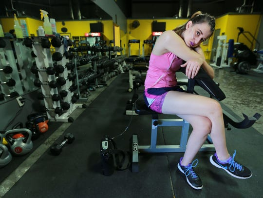 Dima Azzam rests in between sets of exercises during