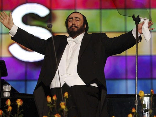 Luciano Pavarotti performs at a 2003 charity concert for Iraqi children in Modena, Italy.