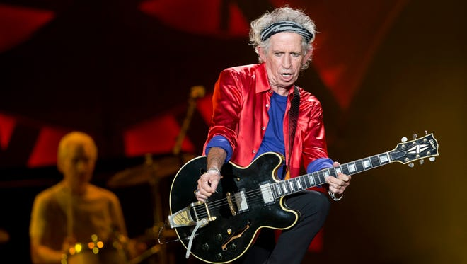 The Rolling Stones' Keith Richards and Charlie Watts, background on drums, perform at Bobby Dodd Stadium on the Georgia Tech campus, in Atlanta.
