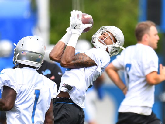 Wide receiver Teo Redding pulls in an over-the-shoulder