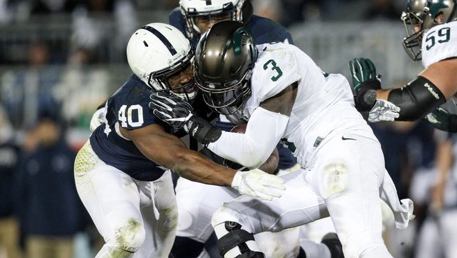 Michigan State running back LJ Scott (3) runs with the ball as Penn State linebacker Jason Cabinda (40) blocks during the third quarter aof MSU's 45-12 loss Saturday in State College, Pa.