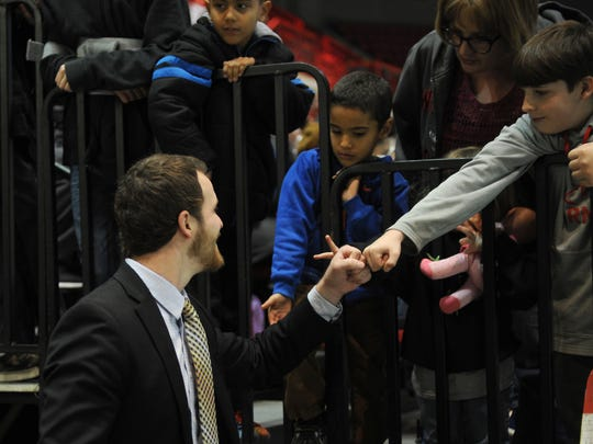 Wichita Falls Wildcats head coach Josh Nelson fist bumps a fna before the start of the second period in the game against the Shreveport Mudbugs Saturday, Jan. 7, 2017, in Kay Yeager Coliseum.