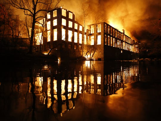 A large portion of the abandoned Bancroft Mills complex burns out of control along the Brandywine in Wilmington after a fire there was reported shortly after 2 a.m.  Nov. 9.