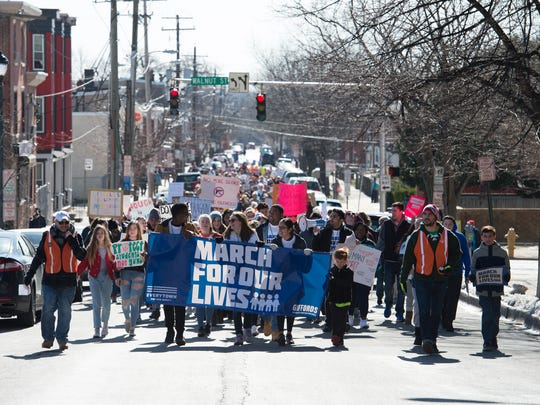 Delaware students march from Howard High School to