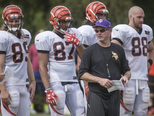Minnesota Vikings head coach Mike Zimmer works the