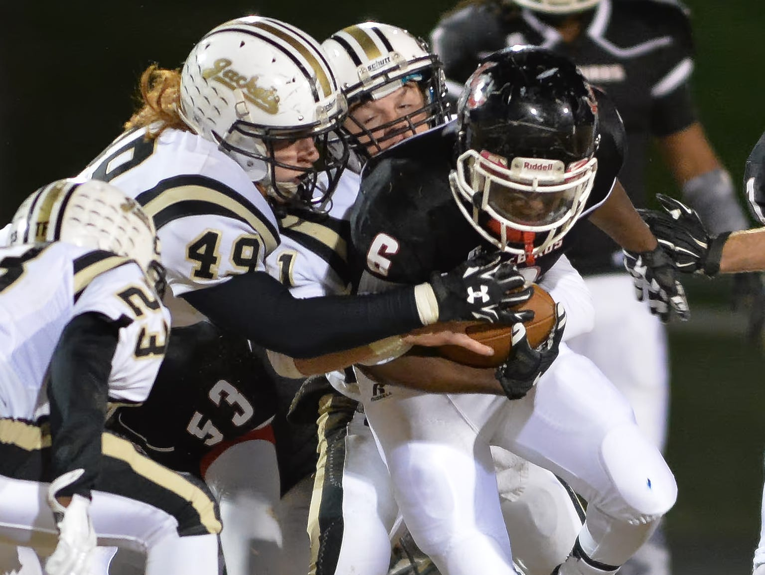 Pear-Cohn's Ke\juan Vaughn battles for yards during a recent playoff game against Springfield. The Firebirds battle Knox Catholic in the 4A state title game Saturday.