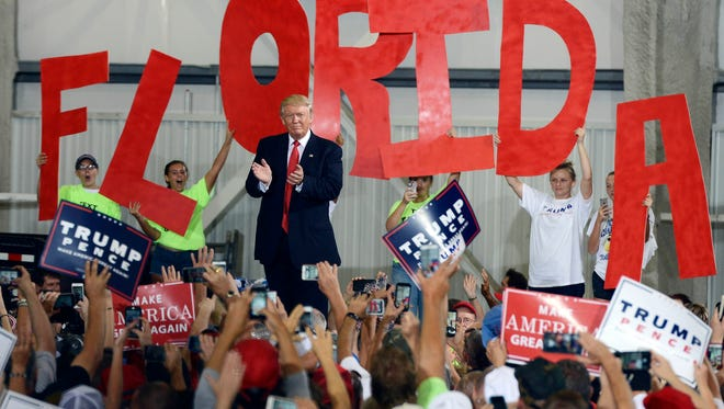Sep 27, 2016; Melbourne, FL, USA; Republican presidential nominee Donald Trump acknowledges the crowd on Sept. 27, 2016, during his campaign appearance in Melbourne.