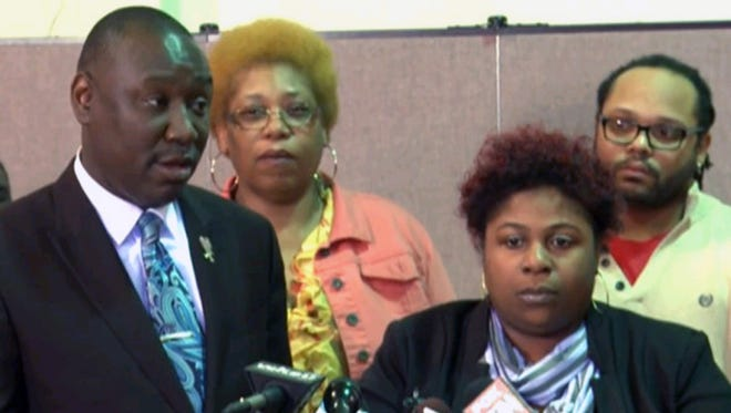 Lawyer Benjamin Crump, left, stands beside Samaria Rice, whose son was killed Nov. 22, 2014, by police as he carried a pellet gun.