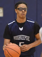 Poughkeepsie High School's Caval Haylett dribbles the