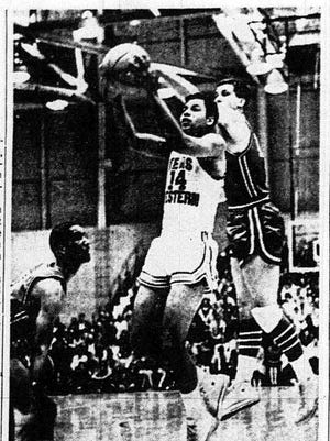 HILL LETS GO - Bobby Joe Hill (14) of the Texas Western Miners lets fly a shot during Jan. 6, 1966's contest with Seattle University at Memorial Gym despite efforts of Steve Looney to block the shot from behind. Jim LaCour gaurds at left. Texas Western won, 75-64 for its 12th victory in a row.