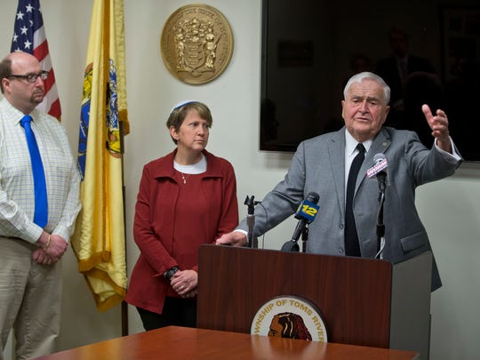 """Jeremy Grunin and Rabbi Ellen S. Wolintz-Fields of Congregation B'nai Israel stand beside the mayor as he speaks. Toms River Mayor Thomas Kelaher holds a press conference to respond to Lakewood mayor's criticism over Kelaher's remarks likening Orthodox Jews to """"an invasion.""""Toms River, NJ Wednesday, March 16, 2016@DhoodHood"""