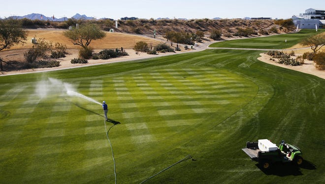 Jose Romero waters the grass on the 17th hole in preparations for the Waste Management Phoenix Open at the TPC in Scottsdale, Ariz. January 28, 2018. The tournament runs from January 29th-February 4th.