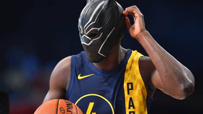 Indiana Pacers guard Victor Oladipo (4) wears a mask for his attempt during the slam dunk contest at Staples Center.