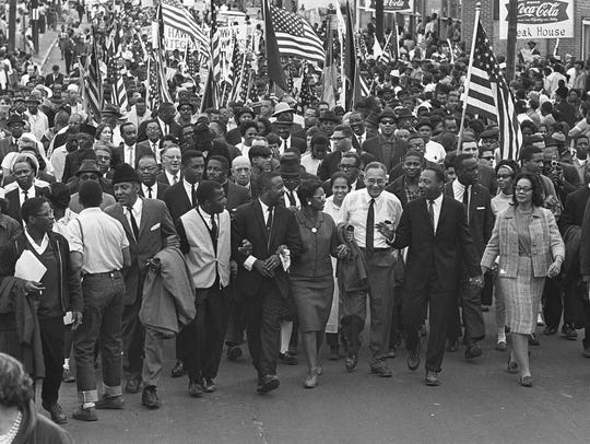 Martin Luther King Jr. leads marchers across the Edmund Pettus Bridge in Selma on March 21, 1965, the first of a five-day, 50-mile march to the state Capitol at Montgomery.