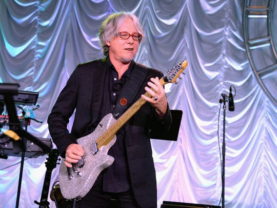 R.E.M. bassist Mike Mills will join violinist Robert McDuffie and the Naples Philharmonic Youth Orchestra in a rock-classical hybrid concerto.
