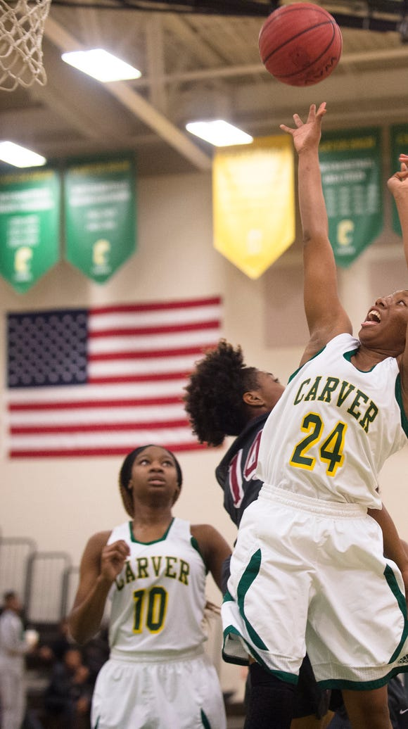 Carver Adasia Rudolph (24) shoots a layup over Stanhope
