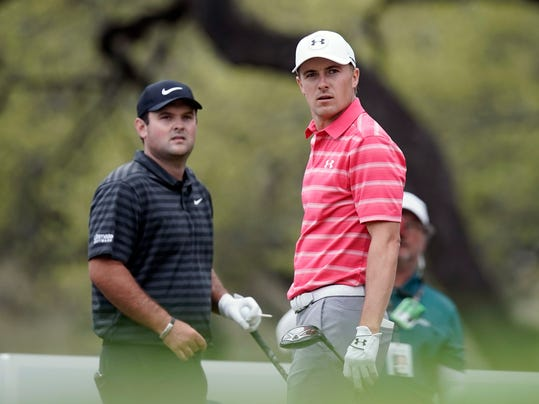 Jordan Spieth, right, watches his drive on the eighth hole as playing partner Patrick Reed looks on as well during round-robin play at the Dell Technologies Match Play golf tournament, Friday, March 23, 2018, in Austin, Texas. (AP Photo/Eric Gay)
