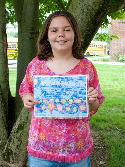 Alexis Colon holds the poster she created for the Tar Wars contest. (Photo submitted by Pennsylvania Academy of Family Physicians)