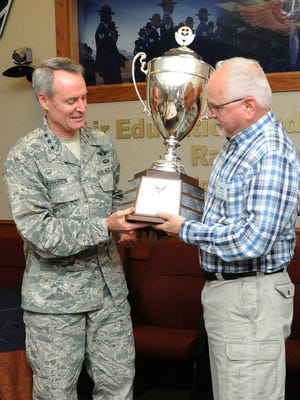 Lt. Gen. Darryl Roberson, commander of Air Education and Training Command, presents the 2015 Altus Trophy to John Veres, Chancellor of Auburn University in Montgomery, Alabama, March 23 at Joint Base San Antonio-Randolph, Texas. The Altus Trophy is given to the community judged to have shown the most outstanding support to an AETC base. Roberson announced Montgomery, Alabama, as the 2015 Altus Trophy winner during the AETC Commander's Civic Leader Group Spring Meeting here.