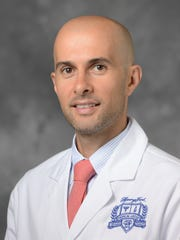 Ali Dabaja, M.D., notes that there are many ways to battle depression after diagnosis, including exercise and seeking social support.