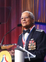 Col. Charles McGee of the Tuskegee Airmen speaks as he is inducted into the National Aviation Hall of Fame in Dayton, Ohio, on July 16, 2011.