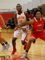 Shamya Butler (15) of Canton tries to gain position in the paint during Thursday's game against Detroit Edison.