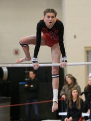 Victoria Faber of Canton works on her bars routine. She won the event in Division 2 with a 9.650 score.
