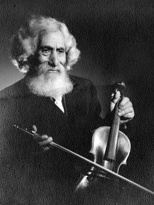 Frank A. Marynell Sr. poses with a violin.
