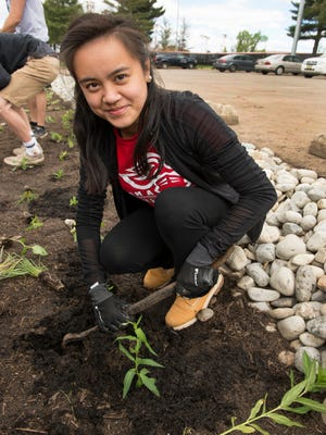Hannah Delos Reyes, Rutgers School of Engineering Class of 2017,  at Linden's rain garden for NFWF-sponsored project Stormwater Green Infrastructure.