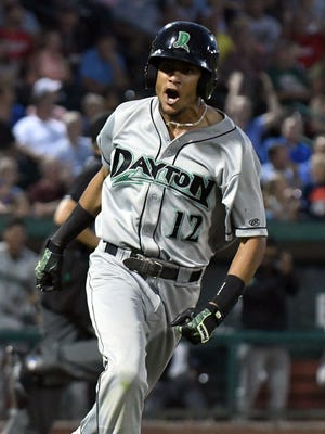 Dayton Dragons OF Jose Siri celebrates an eighth-inning single to extend his hitting streak to a Midwest League-record 36 games in a game in Fort Wayne, Ind., on July 31, 2017.