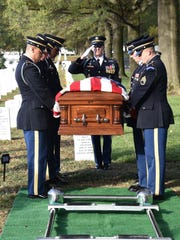 Scene from the military funeral of Richard Lucas, a
