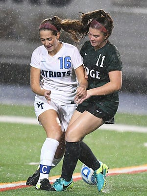 Freehold Twp's (16) Amanda Mienster and Ridge (11) Cailyn Laffey battle for the ball and the elements. Girls Soccer Group 4 final between Freehold Twp and Ridge(Larry Murphy | For the Press)