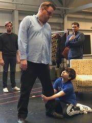 Marlboro's Hayden Bercy grabs the leg of Stephen Wallem