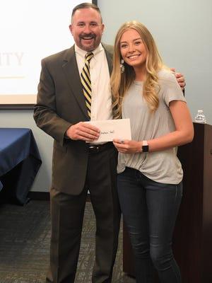 Brayden Hall of Ruidoso received the Sara Daviss Atkinson Scholarship from Marc Tucker.