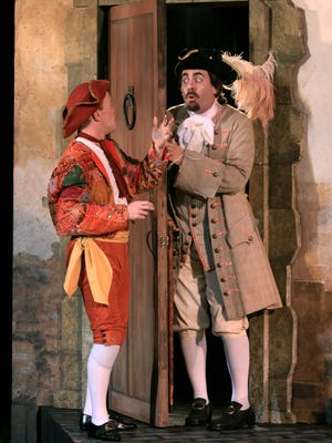 """""""The Servant of Two Masters"""" will be presented at the Outdoor Stage of the Shakespeare Theatre of NJ through June 29. The 18th Century Italian farce by Carlo Goldoni, translated and adapted by Bonnie J. Monte, was previously staged in 2018. Shown in that earlier production are Alex Morf (left) as Truffaldino, the servant of the title, and Jeffrey M. Bender as Brighella."""