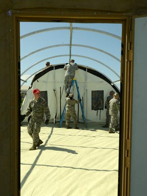 Airmen from the 219th RED HORSE Squadron conference construct a Disaster Relief Bed-down System during a field training exercise at Malmstrom Air Force Base on May 29. DRBD systems have the capability to provide a basic living environment for 150 people and are used during natural disasters.