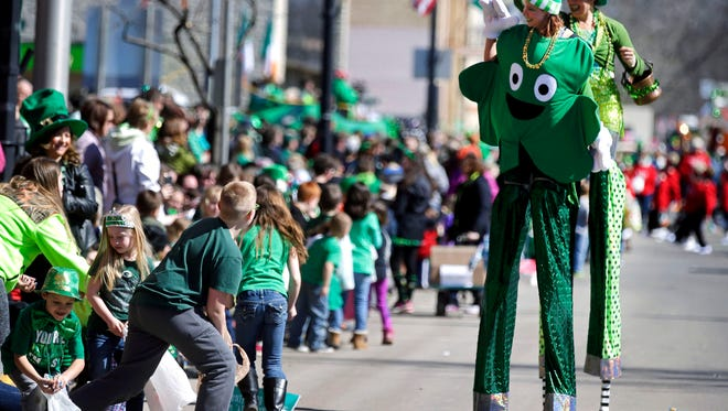 The Jolly Giants stilt walkers entertain the crowd as the St. Patrick's Day Grand Parade takes place Saturday, March 17, 2018, in New London, Wis. The event is hosted by the Shamrock Club Of New Dublin.