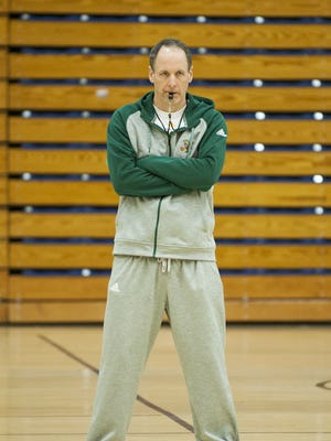 UVM men's basketball head coach John Becker looks on during practice at Patrick Gym on Wednesday afternoon.