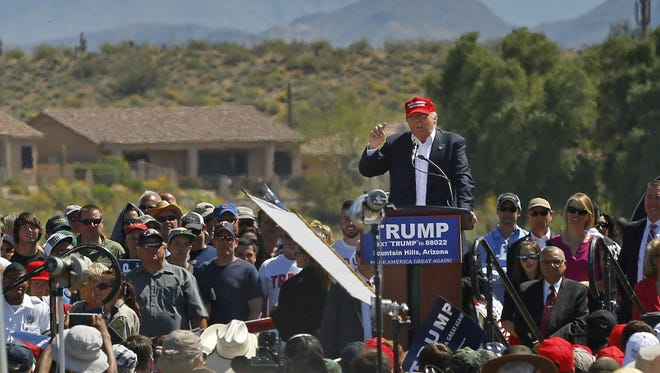 Presidential candidate Donald Trump speaks to supporters on Saturday in Fountain Hills.
