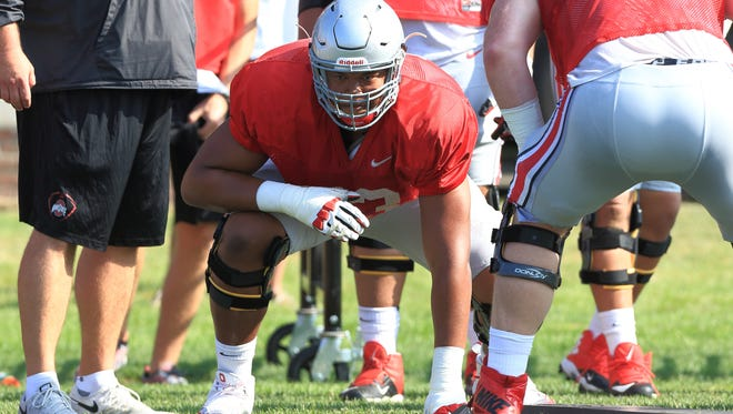 Plymouth grad Michael Jordan gets ready for contact during an Ohio State practice.