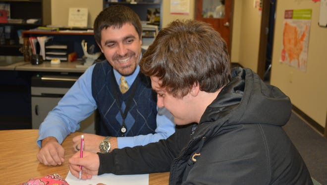 Marion Harding High School assistant principal Ryan Rismiller talks to student Ryan Sayre. The Ohio Association of Secondary School Administrators has named Rismiller as its 2017 Assistant Principal of the Year.