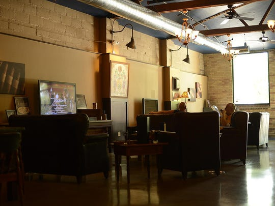 Customers sit inside the Prohibition Spirits and Cigar Lounge in downtown Green Bay.
