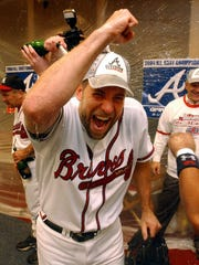 Atlanta Braves' John Smoltz celebrates after the Braves clinched their 13th straight division title with an 8-7 win over the Florida Marlins in Atlanta. Smoltz was elected to the National Baseball Hall of Fame Tuesday, Jan. 6, 2015.