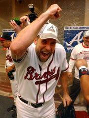 Atlanta Braves' John Smoltz celebrates after the Braves