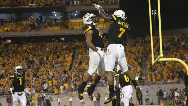 Arizona State running back Kalen Ballage (7) celebrates one of his eight touchdowns against Texas Tech with teammate Demario Richard last Saturday at Sun Devil Stadium in Tempe on Sept. 10, 2016.