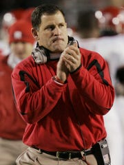 Rutgers coach Greg Schiano applauds one of his teams touchdowns during the first half of their college football game against Louisville in Louisville, Ky., Thursday, Nov. 29, 2007.